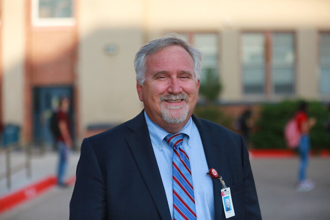 Albuquerque Public Schools superintendent Scott Elder poses for a photo outside of Highland High School on Wednesday, Aug. 11, 2021, in Albuquerque, N.M. Elder said on Tuesday, Aug. 31, 2021 that $50 million in federal pandemic relief funds should be used to offset a drop in enrollment during the pandemic. (AP Photo/Cedar Attanasio)
