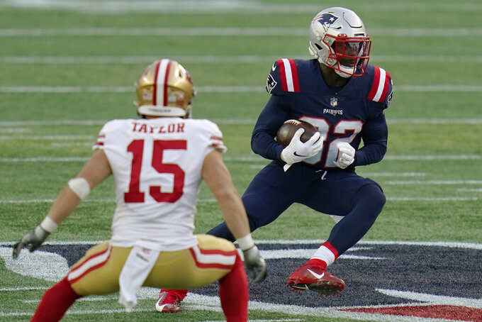 New England Patriots defensive back Devin McCourty, right, runs from San Francisco 49ers wide receiver Trent Taylor (15) after intercepting a pass in the first half of an NFL football game, Sunday, Oct. 25, 2020, in Foxborough, Mass. (AP Photo/Charles Krupa)