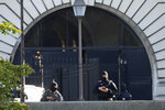 Security forces guard an entrance of the Palace of Justice Wednesday, Sept. 8, 2021 in Paris. France is putting on trial 20 men accused in the Islamic State group's 2015 attacks on Paris that left 130 people dead and hundreds injured. The proceedings begin Wednesday in an enormous custom-designed chamber. Most of the defendants face the maximum sentence of life in prison if convicted of complicity in the attacks. Only Abdeslam is charged with murder. (AP Photo/Francois Mori)