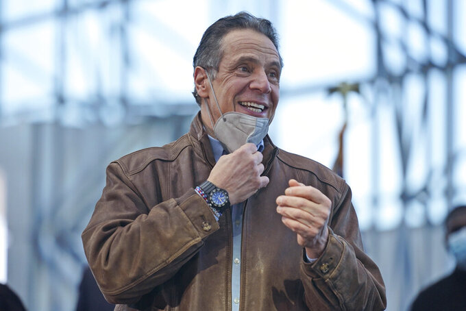 New York Gov. Andrew Cuomo greets people after speaking at a vaccination site on Monday, March 8, 2021, in New York. (AP Photo/Seth Wenig, Pool)