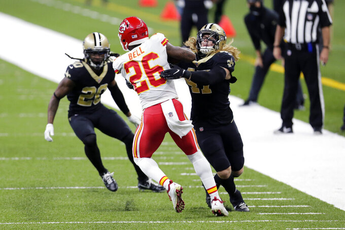 New Orleans Saints middle linebacker Alex Anzalone (47) and cornerback Janoris Jenkins (20) try to contain Kansas City Chiefs running back Le'Veon Bell (26) in the first half of an NFL football game in New Orleans, Sunday, Dec. 20, 2020. (AP Photo/Brett Duke)