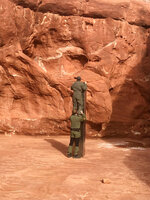 FILE - In this Nov. 18, 2020, file photo provided by the Utah Department of Public Safety, Utah state workers check a metal monolith in the ground in a remote area of red rock in Utah. The mysterious silver monolith that was placed in the Utah desert has disappeared less than 10 days after it was spotted by wildlife biologists performing a helicopter survey of bighorn sheep, federal officials and witnesses said. The Bureau of Land Management said it had received credible reports that the three-sided stainless steel structure was removed on Nov. 27. (Utah Department of Public Safety via AP, File)