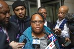 Juanita White, mother of Michael White, is surrounded by reporters as he exits the Stout Center for Criminal Justice, Thursday, Oct. 17, 2019, in Philadelphia, after a jury found her son not guilty in the stabbing death of Sean Schellenger in the Rittenhouse section of the city last July. (Heather Khalifa/The Philadelphia Inquirer via AP)