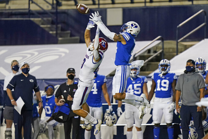 BYU defensive back Troy Warner, right, incepts a pass intended for Louisiana Tech wide receiver Griffin Hebert, left, during the first half of an NCAA college football game Friday, Oct. 2, 2020, in Provo, Utah. (AP Photo/Rick Bowmer, Pool)