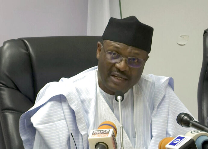 In this image from video, Mahmood Yakubu, chairman of the Independent National Electoral Commission (INEC), speaks about election delayed during a press conference in Abuja, Nigeria, Saturday, Feb. 16, 2019. Nigeria's electoral commission delayed the presidential election until Feb. 23, making the announcement a mere five hours before polls were set to open Saturday. It cited unspecified