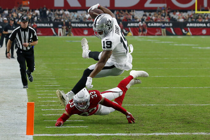 Oakland Raiders wide receiver Ryan Grant (19) scores a touchdown as Arizona Cardinals cornerback Byron Murphy (33) defends during the first half of an an NFL football game, Thursday, Aug. 15, 2019, in Glendale, Ariz. (AP Photo/Rick Scuteri)
