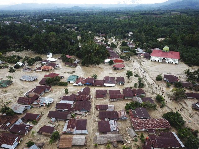 This aerial photo taken using a drone shows an area affected by flash floods in Luwu Utara, South Sulawesi province, Indonesia, Wednesday, July 15, 2020. A number of people were killed and missing after heavy rains in South Sulawesi province swelled rivers and sent flood waters, mud and debris across roads and into thousands of homes. (AP Photo/Khaizuran Muchtamir)