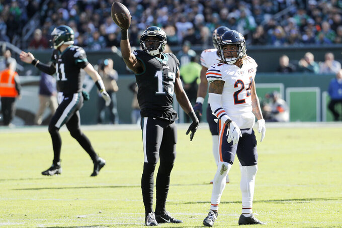 Philadelphia Eagles' Nelson Agholor (13) reacts past Chicago Bears' Buster Skrine (24) after a first down during the first half of an NFL football game, Sunday, Nov. 3, 2019, in Philadelphia. (AP Photo/Chris Szagola)