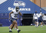 Seattle Seahawks safety Jamal Adams jogs on the field before an NFL football practice Tuesday, Aug. 17, 2021, in Renton, Wash. The Seahawks signed Adams to a four-year contract extension Tuesday that is expected to make the former All-Pro the highest-paid safety in the NFL. (AP Photo/Ted S. Warren)