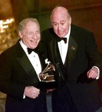 FILE - In this Feb. 24, 1999 file photo, Mel Brooks, left, and Carl Reiner accept their award for best spoken comedy album,