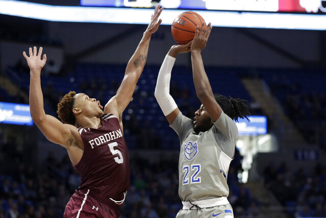 Fordham's Chris Austin (5) blocks a shot by Saint Louis' Terrence Hargrove Jr. (22) during the second half of an NCAA college basketball game Sunday, Jan. 26, 2020, in St. Louis. (AP Photo/Jeff Roberson)