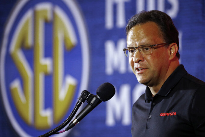 FILE - In this Wednesday, Oct. 17, 2018 file photo, Georgia coach Tom Crean speaks during the SEC men's NCAA college basketball media day in Birmingham, Ala. Tom Crean isn't worried about the low expectations set on his new Georgia team from the outside. The first-year coach is just trying to make sure he doesn't expect too much at the start of his ambitious task of making an also-ran program relevant in the Southeastern Conference and national scene.(AP Photo/Butch Dill, File)
