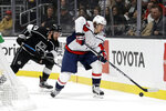 Washington Capitals' Carl Hagelin, right, controls the puck in front of Los Angeles Kings' Kyle Clifford during the first period of an NHL hockey game Wednesday, Dec. 4, 2019, in Los Angeles. (AP Photo/Marcio Jose Sanchez)