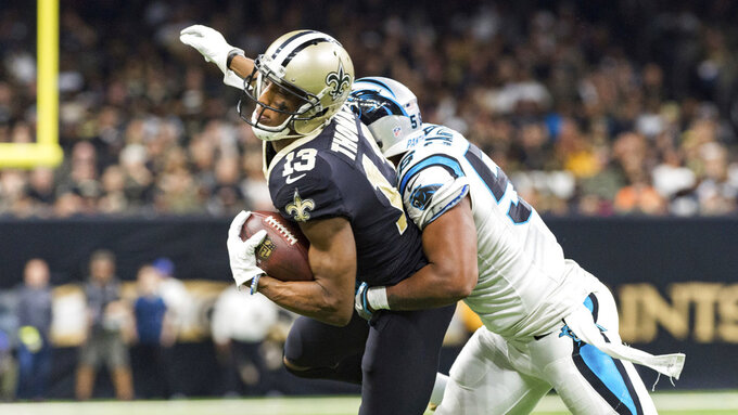 New Orleans Saints receiver Michael Thomas makes a catch during an NFL football game against the Carolina Panthers, Sunday, Dec. 30, 2018 in New Orleans. (Scott Clause/The Daily Advertiser via AP)