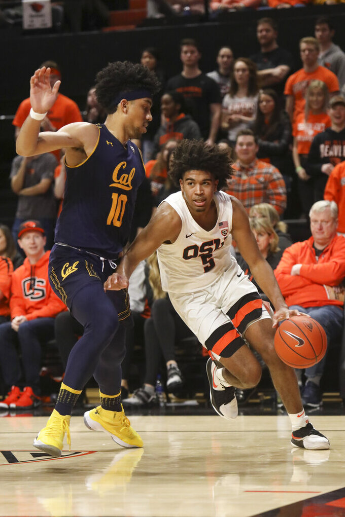 Oregon State's Ethan Thompson (5) skirts past California's Justice Sueing (10) during the second half of an NCAA college basketball game in Corvallis, Ore., Saturday, Feb. 9, 2019. Oregon State won, 79-71. (AP Photo/Amanda Loman)