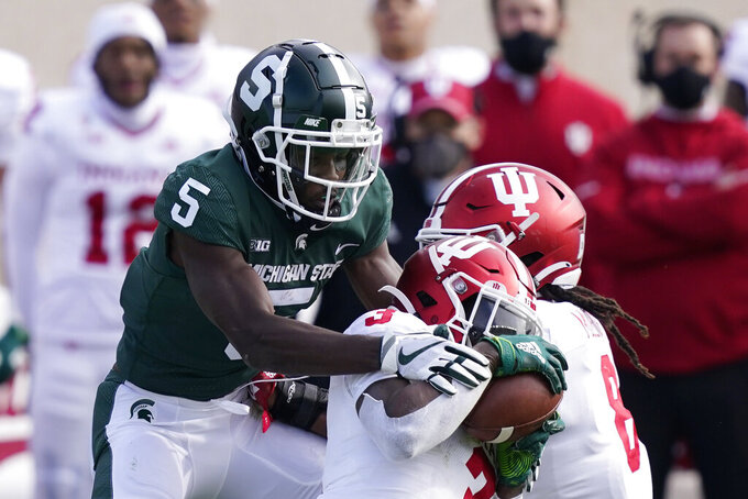 Indiana defensive back Tiawan Mullen (3) intercepts a pass intended for Michigan State wide receiver Jayden Reed (5) during the first half of an NCAA college football game, Saturday, Nov. 14, 2020, in East Lansing, Mich. (AP Photo/Carlos Osorio)