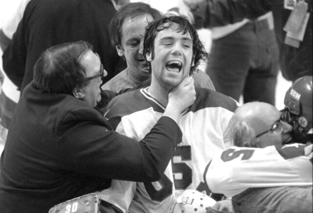 "*ATTENTION AP SPORTS PHOTO DESK, EMBARGOED UNTIL 12:01AM ON FRIDAY, DECEMBER 21, 2020* In this Feb. 22, 1980, photo, Team USA goaltender Jim Craig got a hug from goalie coach Warren Strelow in the moments after defeating the Soviet Union during the medal-round of the Winter Olympics in Lake Placid, N.Y. Tourism is a $1.2 billion industry in the Lake Placid region, much of it still fueled by the memory of the U.S. hockey team beating the Soviet Union as the ""Miracle on Ice"