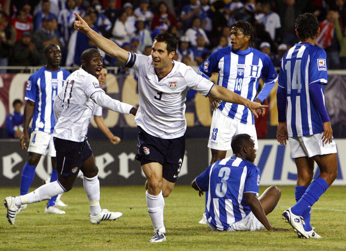 FILE - United States' Carlos Bocanegra (3) celebrates after scoring the winning goal against Honduras during the second half of a South Africa 2010 World Cup qualifier soccer match in Chicago. Former U.S. national team defender Carlos Bocanegra will be the lone inductee to the National Soccer Hall of Fame for 2020. Bocanegra, currently technical director for Atlanta United, will be enshrined in a ceremony with the 2021 class next year at Toyota Stadium in Frisco, Texas. Originally scheduled for Saturday, Sept. 12, 2020, this year's ceremony was canceled because of the coronavirus pandemic. (AP Photo/Nam Y. Huh, File)