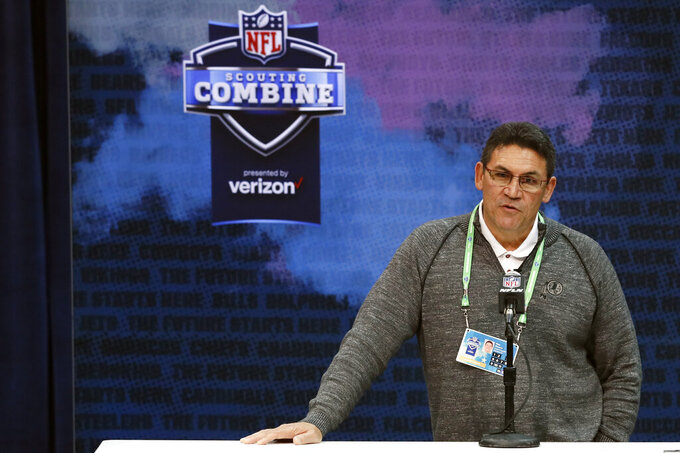 FILE - In this Feb. 26, 2020, file photo, Washington Redskins head coach Ron Rivera speaks during a press conference at the NFL football scouting combine in Indianapolis. This is supposed to be the Redskins' Chase Young draft. The chance to select the Ohio State pass-rusher with the second overall pick is a possible silver lining of a 3-13 season. Young is considered the top defensive player available after putting up 46 tackles and 16 1/2 sacks last year. New Redskins coach Ron Rivera cautioned to wait to see what happens with the No. 1 pick first. He has also taken calls from other teams about trading down. (AP Photo/Charlie Neibergall, File)