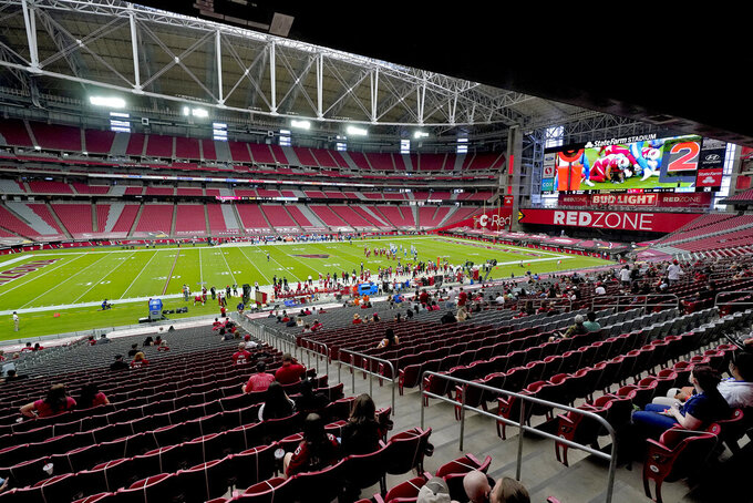 A limited number of fans watch during the first half of an NFL football game between the Detroit Lions and the Arizona Cardinals, Sunday, Sept. 27, 2020, in Glendale, Ariz. (AP Photo/Ross D. Franklin)