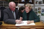 New Hampshire Secretary of State Bill Gardner instructs Democratic presidential candidate U.S. Sen. Elizabeth Warren, D-Mass., as she files to have her name listed on the New Hampshire primary ballot, Wednesday, Nov. 13, 2019, in Concord, N.H. (AP Photo/Charles Krupa)