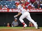 FILE - In this July 27, 2019, file photo, Los Angeles Angels' Mike Trout runs to first while watching his two-run home run during the first inning of the team's baseball game against the Baltimore Orioles in Anaheim, Calif. Trout won his third AL MVP Award on Thursday, Nov. 14, 2019. Trout got 17 of 30 first-place votes in balloting by the Baseball Writers' Association of America. (AP Photo/Mark J. Terrill)