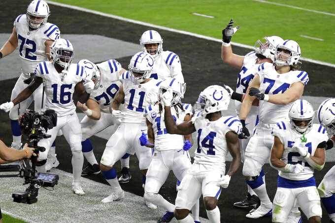 Indianapolis Colts celebrate after scoring a touchdown against the Las Vegas Raiders during the first half of an NFL football game, Sunday, Dec. 13, 2020, in Las Vegas. (AP Photo/Isaac Brekken)