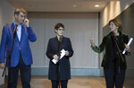 The chairmen of Germany's governing parties, Markus Soeder (CSU), Annegret Kramp-Karrenbauer (CDU) and Malu Dreyer (SPD), from left, talk to the media at a press conference in Berlin, Sunday, Nov. 10, 2019, to confirm agreement on a reform of the country's pension system, setting aside an ideological dispute that had threatened to unravel the coalition government. (Soeren Stache/dpa via AP)