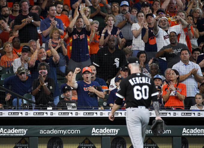 Fans cheer as Chicago White Sox starting pitcher Dallas Keuchel (60) walks to the dugout after being removed from the baseball game during the third inning against the Houston Astros, Sunday, June 20, 2021, in Houston. (AP Photo/Eric Christian Smith)
