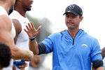 Los Angeles Chargers head coach Brandon Staley greets players at NFL football practice in Costa Mesa, Calif., Friday, Aug. 6, 2021. (AP Photo/Alex Gallardo)