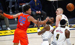 Oklahoma City Thunder forward Isaiah Roby, left, reaches out for a loose ball as it bounds past Denver Nuggets forward Will Barton, second from left, and forward Paul Millsap, front right, and center Nikola Jokic in the second half of an NBA basketball game Tuesday, Jan. 19, 2021, in Denver. (AP Photo/David Zalubowski)