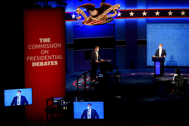Stand-ins participate in rehearsal tests ahead of the final presidential debate between Republican candidate President Donald Trump and Democratic candidate former Vice President Joe Biden, Wednesday, Oct. 21, 2020, in Nashville, Tenn. The debate will take place Thursday, Oct. 22 at the Curb Event Center at Belmont University. (AP Photo/Julio Cortez)