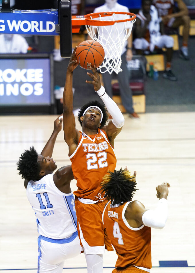 Texas forward Kai Jones (22) grabs a rebound over North Carolina forward Day'Ron Sharpe (11) in the first half of an NCAA college basketball game for the championship of the Maui Invitational, Wednesday, Dec. 2, 2020, in Asheville, N.C. (AP Photo/Kathy Kmonicek)
