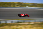 Ferrari driver Charles Leclerc of Monaco steers his car through one of the banked corners during the first free practice ahead of Sunday's Formula One Dutch Grand Prix at the Zandvoort racetrack, Netherlands, Friday, Sept. 3, 2021. (AP Photo/Francisco Seco)