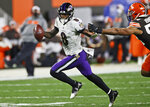 Baltimore Ravens quarterback Lamar Jackson (8) scrambles during the first half of an NFL football game against the Cleveland Browns, Monday, Dec. 14, 2020, in Cleveland. (AP Photo/Ron Schwane)