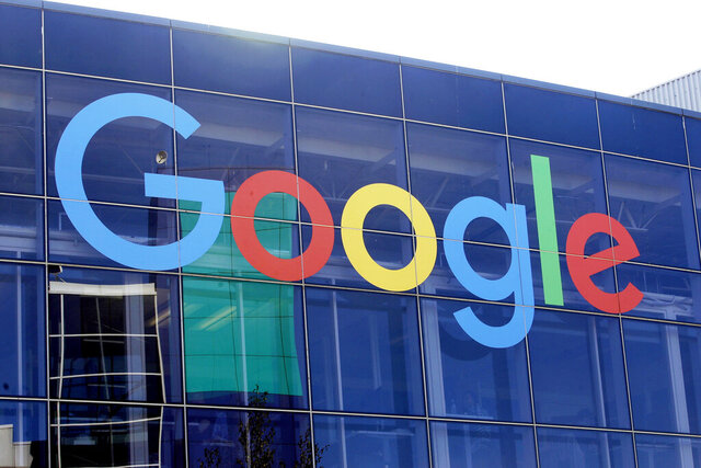 FILE - In this Sept. 24, 2019, file photo a sign is shown on a Google building at their campus in Mountain View, Calif.   The European Court of Auditors, which has examined the EU's enforcement of competition rules over the past decade, says antitrust investigations have taken too long, dulling their effectiveness.  Google is currently appealing a 2.4 billion euro ($2.9 billion) antitrust fine levied in 2017 that stems from an investigation into its shopping search results that began a decade ago.(AP Photo/Jeff Chiu, FILE)