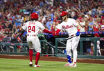 Philadelphia Phillies' Roman Quinn (24) celebrates with Bryce Harper after hitting a home run off of San Diego Padres' Chris Paddack during the third inning of a baseball game Friday, Aug. 16, 2019, in Philadelphia. (AP Photo/Matt Rourke)