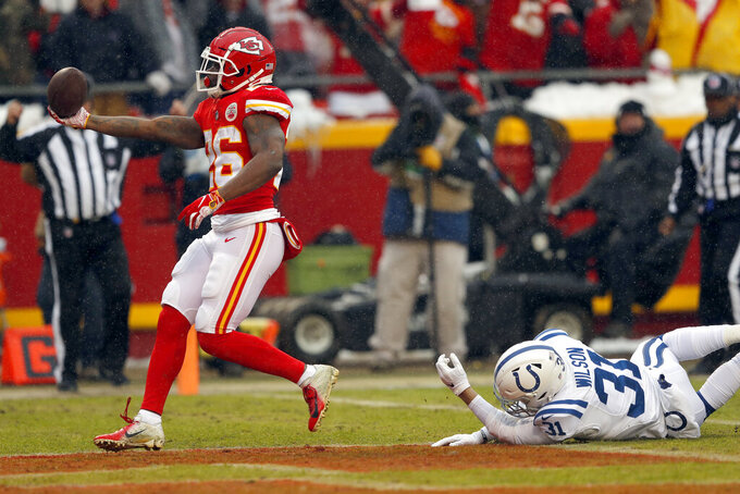 Kansas City Chiefs running back Damien Williams (26) scores a touchdown ahead of Indianapolis Colts cornerback Quincy Wilson (31) during the first half of an NFL divisional football playoff game in Kansas City, Mo., Saturday, Jan. 12, 2019. (AP Photo/Charlie Neibergall)