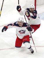 Columbus Blue Jackets center Matt Duchene, front, celebrates with Nick Foligno (71) after his game-winning goal past Boston Bruins goaltender Tuukka Rask (40) during double overtime of Game 2 of an NHL hockey second-round playoff series, early Sunday, April 28, 2019, in Boston. The Blue Jackets won 3-2. (AP Photo/Charles Krupa)
