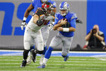 Detroit Lions quarterback David Blough (10) is sacked by Tampa Bay Buccaneers linebacker Carl Nassib (94) during the first half of an NFL football game, Sunday, Dec. 15, 2019, in Detroit. (AP Photo/Paul Sancya)