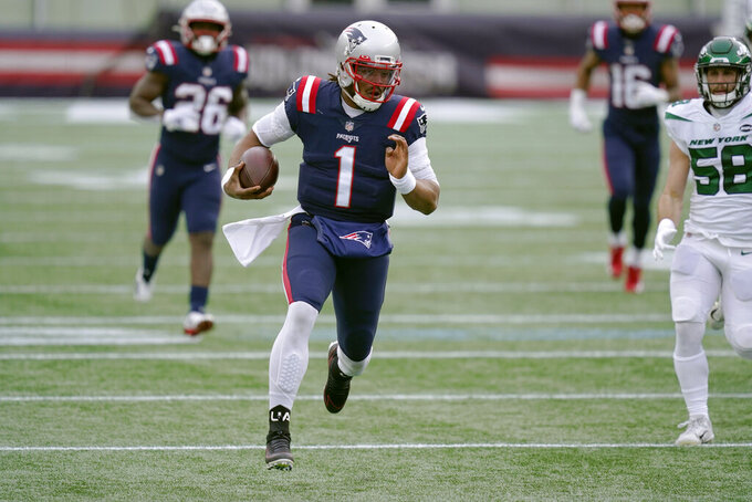 New England Patriots quarterback Cam Newton carries the ball against the New York Jets in the first half of an NFL football game, Sunday, Jan. 3, 2021, in Foxborough, Mass. (AP Photo/Elise Amendola)