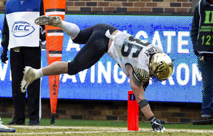 Wake Forest's Cade Carney dives for a touchdown late in the second half of an NCAA college football game against Duke in Durham, N.C., Saturday, Nov. 24, 2018. (AP Photo/Ben McKeown)