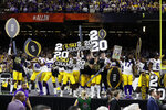 LSU celebrates after winning a NCAA College Football Playoff national championship game against Clemson, Monday, Jan. 13, 2020, in New Orleans. LSU won 42-25. (AP Photo/Sue Ogrocki)