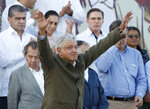 Mexican President Andres Manuel Lopez Obrador receives the applause of the crowd during a rally in Tijuana, Mexico, Saturday, June 8, 2019. Mexican President Andres Lopez Obrador held the rally in Tijuana even as President Trump has put on hold his plan to begin imposing tariffs on Mexico on Monday, saying the U.S. ally will take
