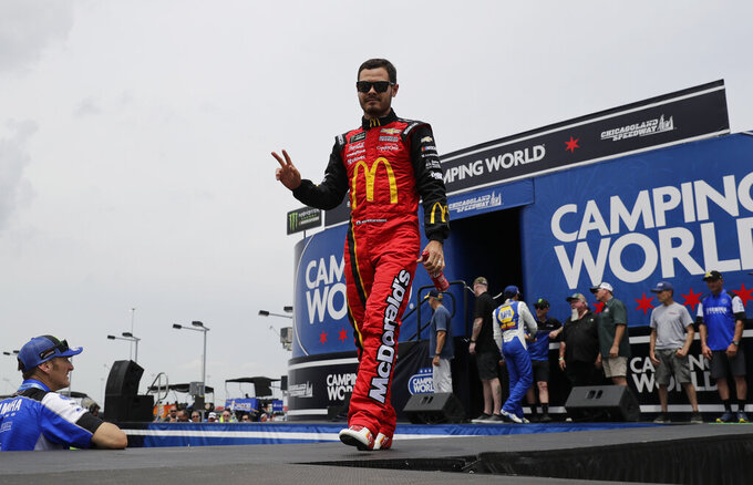 Kyle Larson waves to the crowd during drivers introduction before the NASCAR Cup Series auto race at Chicagoland Speedway in Joliet, Ill., Sunday, June 30, 2019. (AP Photo/Nam Y. Huh)