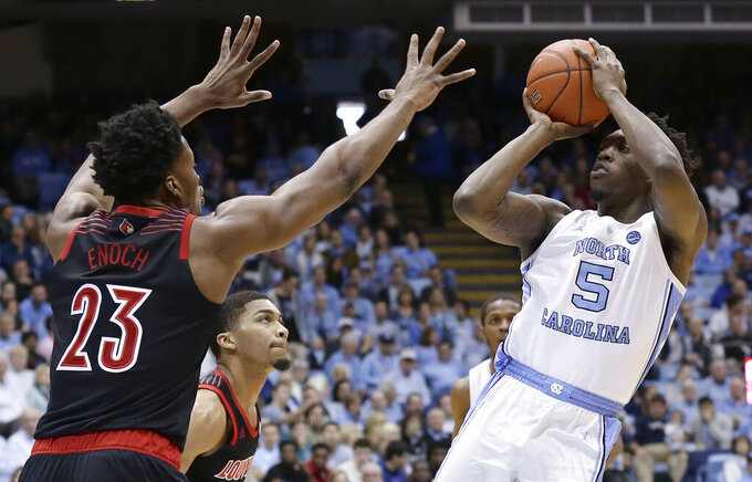 North Carolina's Nassir Little (5) shoots over Louisville's Steven Enoch (23) during the first half of an NCAA college basketball game in Chapel Hill, N.C., Saturday, Jan. 12, 2019. (AP Photo/Gerry Broome)