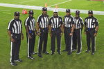 NFL officials, from left, umpire Barry Anderson, field judge Anthony Jeffries, down judge Julian Mapp, referee Jerome Boger, back judge Greg Steed, side judge Dale Shaw (104), line judge Carl Johnson (101) pose for a photo before an NFL football game between the Tampa Bay Buccaneers and the Los Angeles Rams Monday, Nov. 23, 2020, in Tampa, Fla. The game is the first in NFL history to feature an all African-American officiating crew. (AP Photo/Jason Behnken)