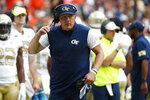FILE  - In this Saturday, Oct. 19, 2019, file photo, Georgia Tech head coach Geoff Collins is shown during the first half of an NCAA college football game against Miami, in Miami Gardens, Fla.  Early in Collins' second season as coach, the Yellow Jackets are still learning painful lessons about turnovers and other mistakes. Louisville and Georgia Tech will be looking to clean up mistakes, including interceptions, that have left each team with two straight losses. (AP Photo/Wilfredo Lee, File)