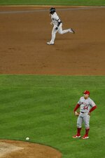 Los Angeles Angels starting pitcher Jose Suarez (54) reacts as New York Yankees' Gleyber Torres runs the bases after hitting a two-run home run during the fourth inning of a baseball game Tuesday, Sept. 17, 2019, in New York. (AP Photo/Frank Franklin II)