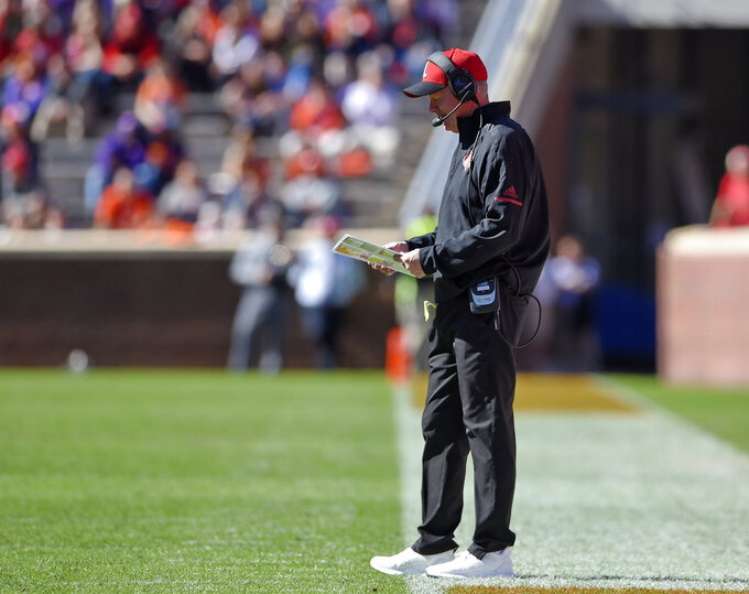 Louisville head coach Bobby Petrino works on the sideline during the first half of an NCAA college football game against Clemson, Saturday, Nov. 3, 2018, in Clemson, S.C. (AP Photo/Richard Shiro)